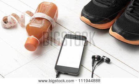 Running Shoes,orange Juice,measuring Tape And Phone