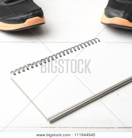 Running Shoes And Notepad