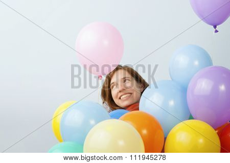 Woman Surrounded by Balloons