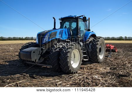 Blue Tractor With Plow