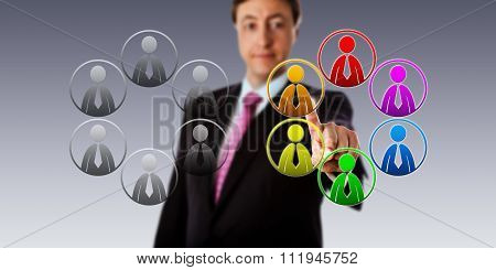 Happy manager selecting a multicolored team of male workers over a plain gray group. Business concept for diversity equal opportunity employment and team building in a multicultural organization. poster