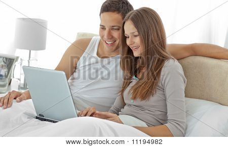 Young Couple Watching A Video On The Laptop