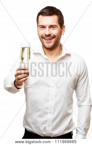 Young man carries glass of champaign