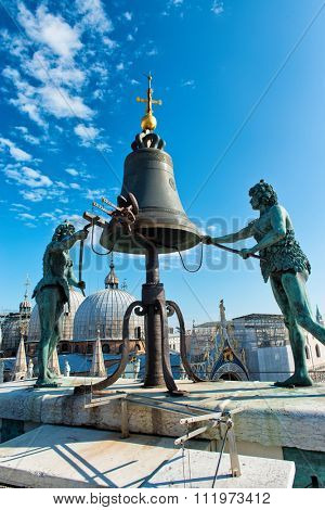 VENICE, ITALY - 17 OCTOBER 2015: Torre dell'Orologio (St Mark's Clocktower) in Venice, Italy. At the top of the tower are two bronze figures which strike the hours on a bell. October 17 2015.