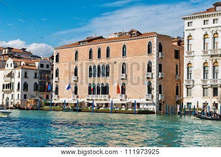 VENICE, ITALY - 17 OCTOBER 2015: Exterior of the Gritti Palace Hotel, Venice with its outdoor restaurant terrace overlooking the Grand Canal viewed from the water. Venice, Italy on 17 October 2015.