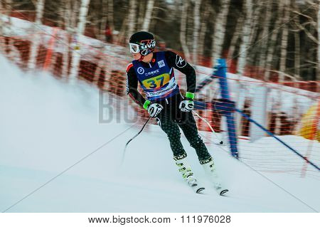 man athlete after finish spray of snow during Russian Cup in alpine skiing