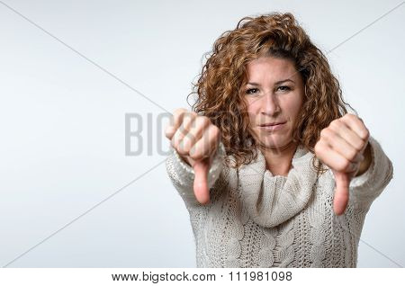 Young Woman Giving A Thumbs Down Gesture