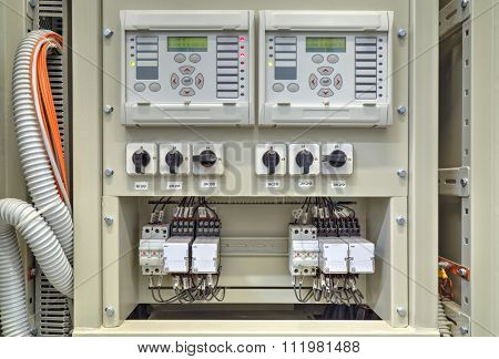 Electrical control panel with electronic devices in electrical substation
