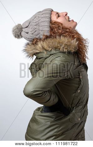 Young Woman With Winter Back Ache