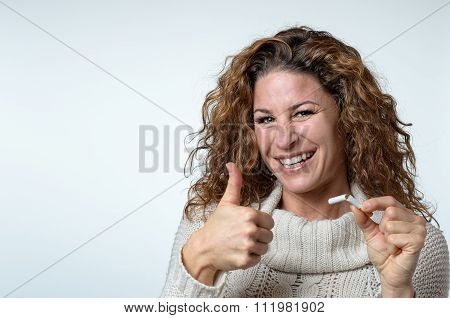 Cute Woman Giving A Thumbs Up Gesture