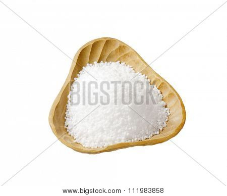 Coarse grained salt in triangle wooden bowl