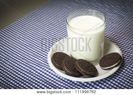 Milk With Cookies On A Blue And White Map