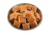 A bowl full of blocks of dark brown sugar made of cane sugar (jaggery), by evaporation of the sap of sugar cane juice poster