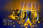 Two champagne flutes clink glasses at the party blue yellow background with blurred golden lights and text Happy New Year 2016 poster