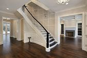 Foyer in new construction home with curved staircase poster