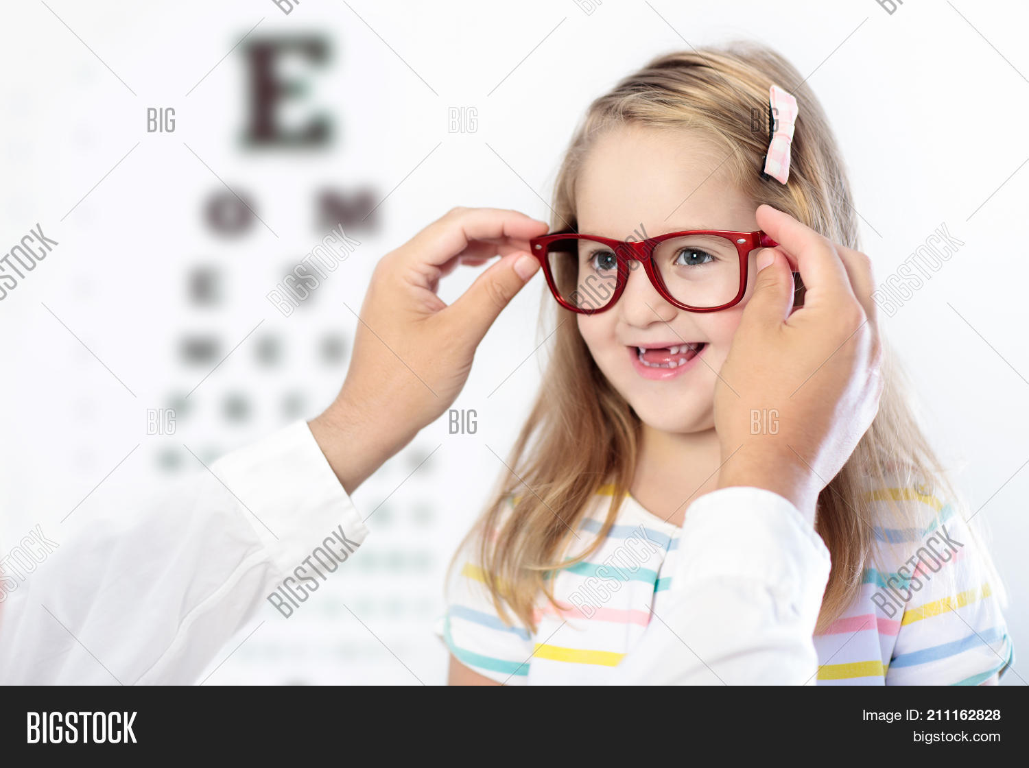 Child eye sight test little kid image photo bigstock child at eye sight test little kid selecting glasses at optician store eyesight measurement geenschuldenfo Images