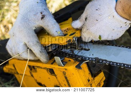 Repair Of Chainsaws. Old Saw Broke Down On The Job