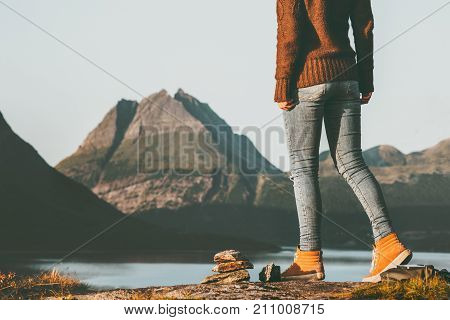 Adventurer woman feet hiking in Norway mountains landscape Travel Lifestyle concept active weekend vacations outdoor