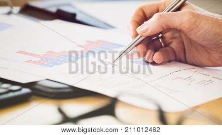 Hand Checking Financial Documents
