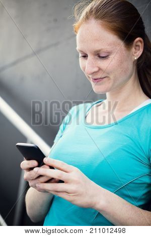 Active Fit Woman With Smartphone