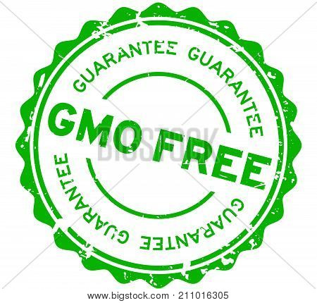 Grunge green GMO free guarantee word round rubber seal stamp on white background