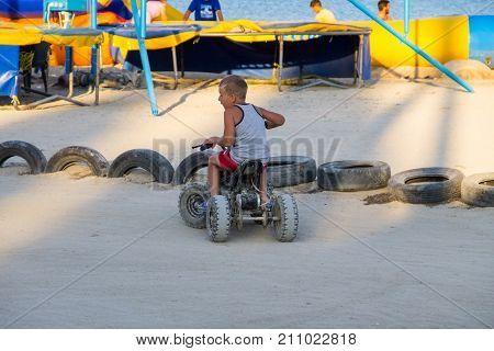 Little Boy Driving Toy Car