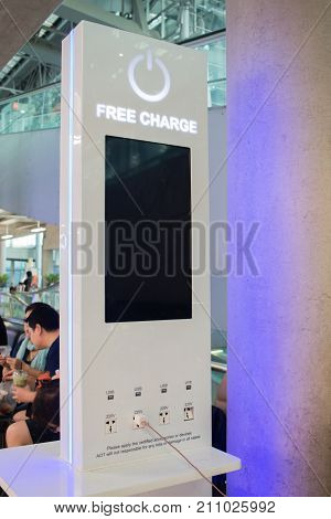 BANGKOKTHAILAND - SEPTEMBER 152017: Free charging staion Charger Spot electric vehicle charging station with Various Plug-ins for passenger in terminal at Suvarnabhumi Airport in BangkokThailand.