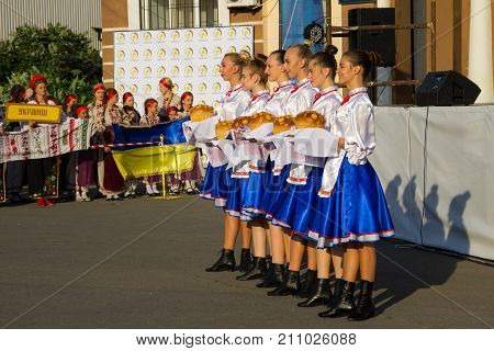 Girls In Ukrainian Traditional Clothing Prepare To Welcome Guests Of Festival