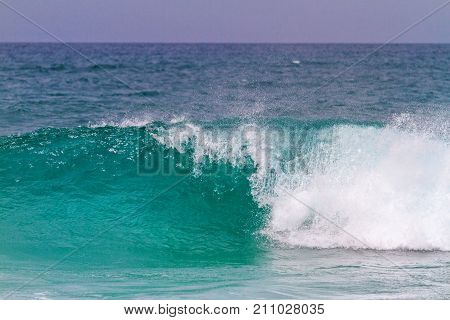 turquoise wave breaks up to the shore , surfing, seas and oceans