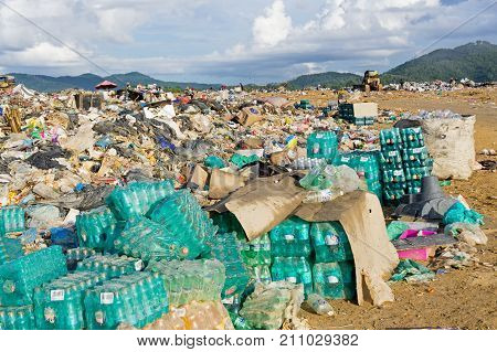 Kota Kinabalu Malaysia - July 08 2017: Stacked of expired Coco Cola and other drinks in a carton at the landfill in Kayu Madang landfill in Sabah Borneo.