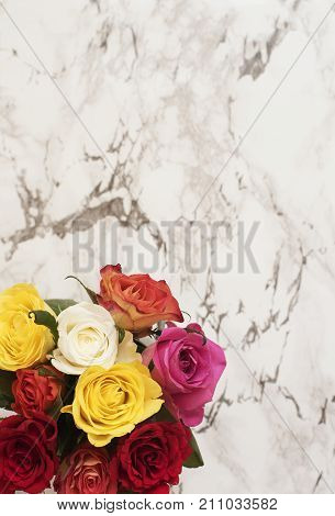 Beautiful Fresh Flowers On Light Marble Table, Top View. Colorful Bouquet Of Roses