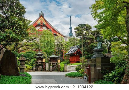 TOKYO, JAPAN - OCTOBER 18: Tradition and Modernity in Japan. View of Asakusa old Buddhist Temple shrines with the modern Skytree Tower OCTOBER 18, 2017 in Tokyo, Japan