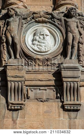 Italy Tuscany Florence - October 23, 2017: Leonardo Da Vinci by Olinto Calastri (1920) portrait medallion on the National Central Library facade.