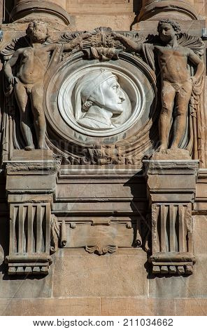 Italy Tuscany Florence - October 23 2017: Dante Alighieri by Olinto Calastri (1920) portrait medallion on the Central National Library facade.