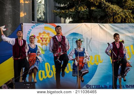 Dancers In Bulgarian Traditional Clothing Performs On Stage