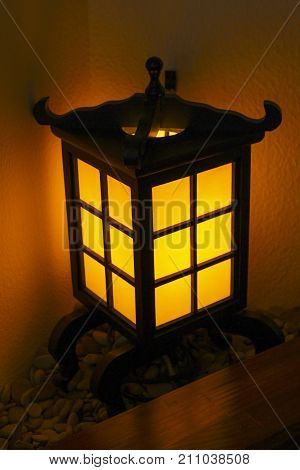 Decorative lantern in a Japanese style in a corner near the table