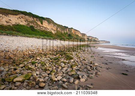 Cliffs on Omaha beach near Vierville-sur-Mer (Normandy France) on a summer morning