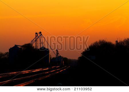 Sunset on the BNSF Transcon Railroad and Grain Elevator
