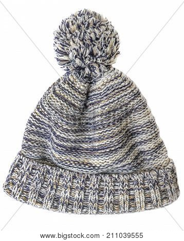 Knitted cap with a pompon of multicolored threads isolated on white background