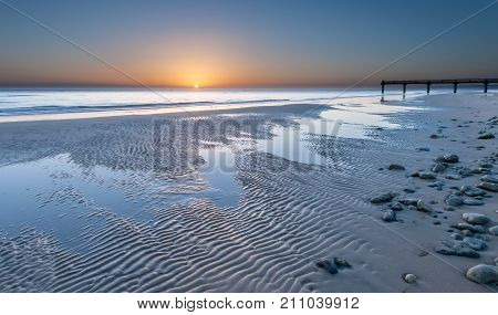 Omaha beach near Vierville-sur-Mer (Normandy France) on a summer morning sunrise