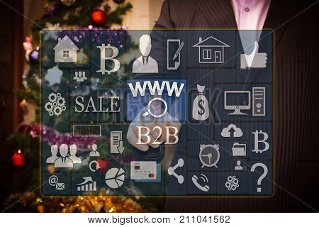 The Businessman Chooses Www Online Searches On The Touch Screen, The Backdrop Of The Christmas Tree