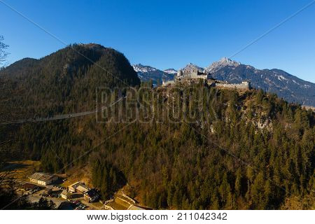 REUTTE, AUSTRIA - DECEMBER 2016: Highline179 world's longest suspension pedestrian bridge in Tibet style with length of 406 m. between fort Claudia and Ehrenberg, December 29, 2016 in Reutte, Austria