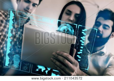 Businesspeople using tablet with abstract digital business interface. Teamwork and future concept