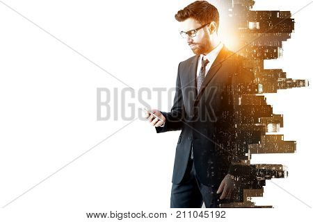 Side view of handsome young businessman using smartphone on abstract glowing white city background with copy space. Communication concept. Double exposure