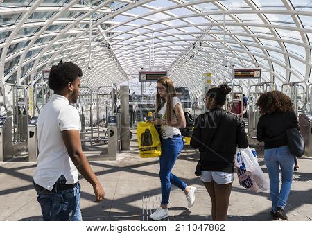 The Hague The Netherlands - August 6 2017: Central Train Station The Hague with travellers at the HTM tram metro station.