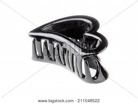 Women's black plastic hair clip isolated on white