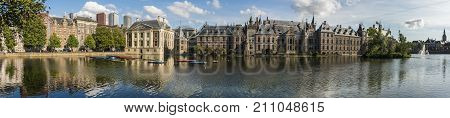 The Hague The Netherlands - August 6 2017: Museum 'Mauritshuis' the 'Torentje' of prime minister and parliament of the Netherlands in front the pond 'the Hofvijver'.