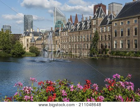 The Hague The Netherlands - August 6 2017: Parliament buildings museum 'Mauritshuis' skyscrapers and the 'Torentje' of prime minister of the Netherlands in front the pond 'the Hofvijver'.