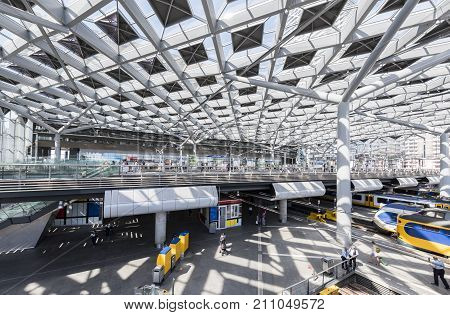 The Hague The Netherlands - August 6 2017: Central Train Station The Hague with construction trains platforms and glass windows.