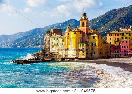 Scenic Mediterranean riviera coast. Panoramic view of Camogli town in Liguria, Italy. Basilica of Santa Maria Assunta and colorful palaces.